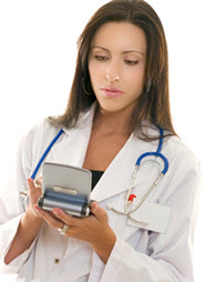 Physician using a small tablet computer