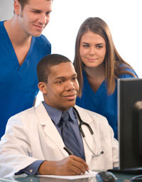 Doctor and two other staffers looking at computer