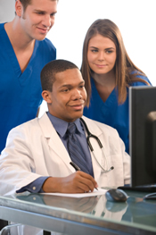 Doctor and staffers at computer