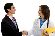 Salesman and doctor shaking hands