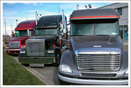 Three new semi tractors at a dealership
